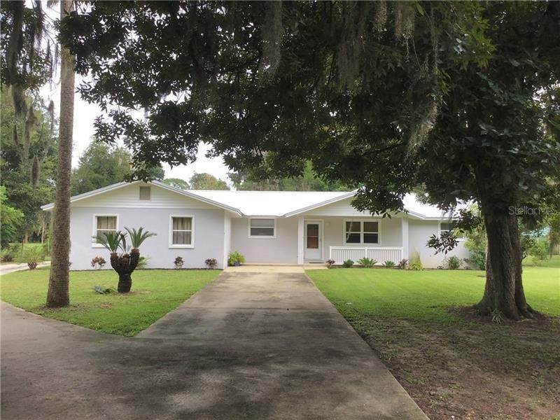 Single Family Homes por un Venta en 6021 SPRUCE CREEK ROAD Port Orange, Florida 32127 Estados Unidos
