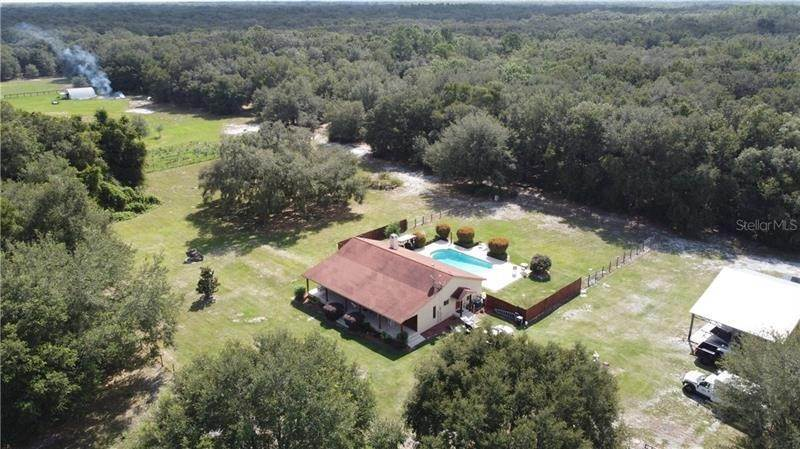 Single Family Homes por un Venta en 3407 SE 29TH BOULEVARD Sumterville, Florida 33585 Estados Unidos