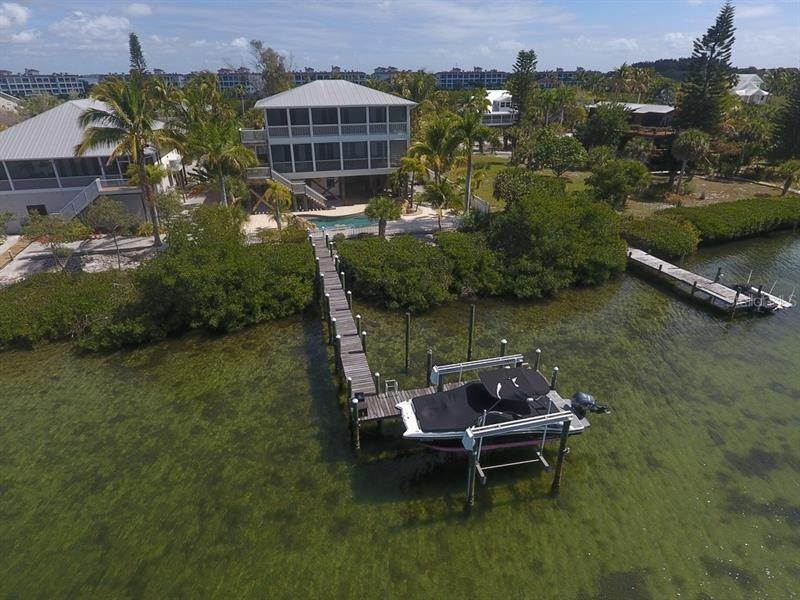 3. Single Family Homes for Sale at 241 KETTLE HARBOR DRIVE Placida, Florida 33946 United States