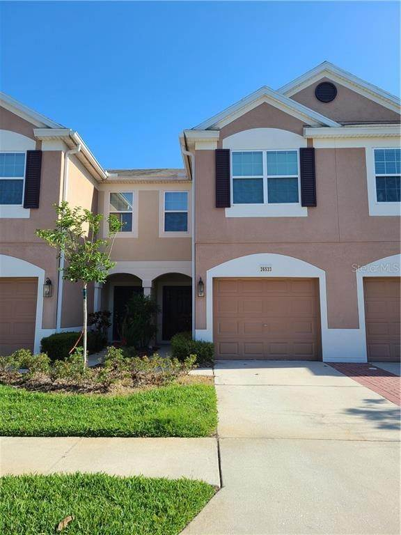 3. townhouses for Sale at 26533 CASTLEVIEW WAY Wesley Chapel, Florida 33544 United States