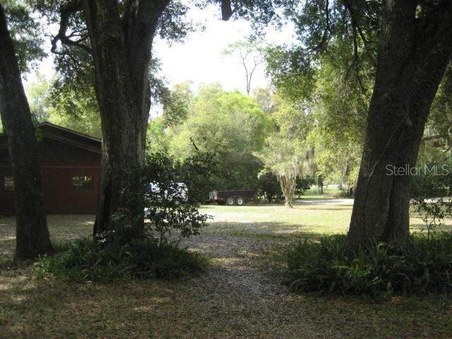 14. Single Family Homes for Sale at 1003 HILLTOP STREET Fruitland Park, Florida 34731 United States