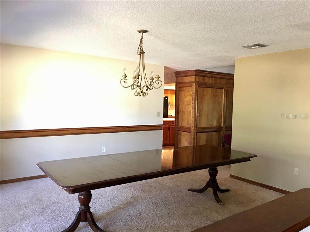 19. Single Family Homes for Sale at 1003 HILLTOP STREET Fruitland Park, Florida 34731 United States