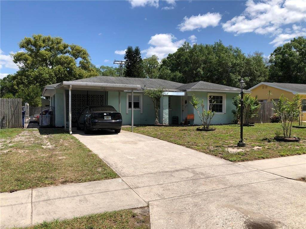 Single Family Homes for Sale at 10707 N WATERHOLE PLACE Tampa, Florida 33612 United States